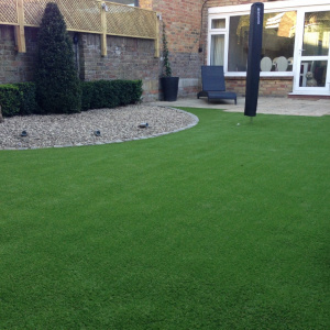 artifical grass installed in a weybridge garden