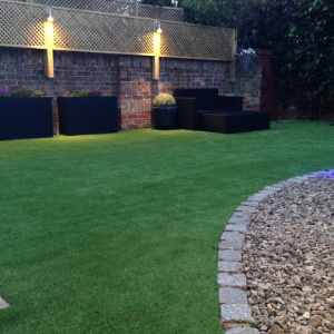 fake grass in garden at dusk