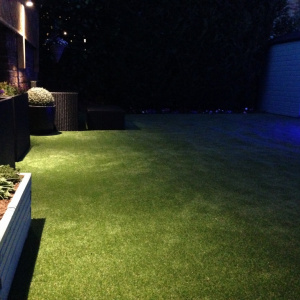 artificial grass install in weybridge garden