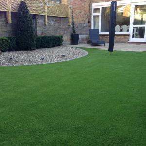 artifical grass installed in a weybridge garden