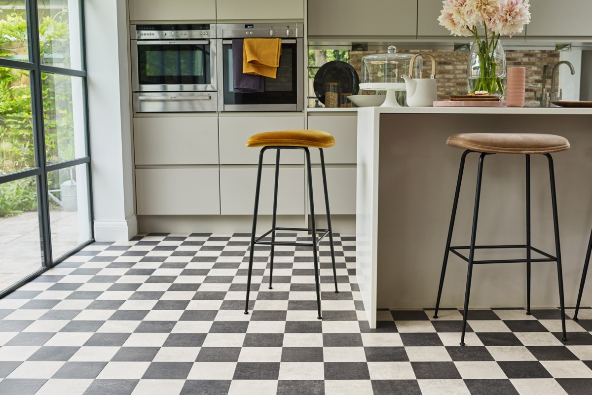 Amtico Check Plaid Two modern stones coordinate in Check for an injection of style into any space. Here Kura Kala and Kura Opium create a modern twist on a classic kitchen floor style for a fun and contemporary kitchen floor finish.