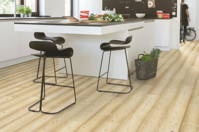 Quick Step Natural Pine Embrace Scandinavian style with a light pine finish. Delivering a modern Nordic feel the light wood effect planks of Quick Step Natural Pine are made from the finest materials and built to last. Perfect for modern white kitchen design with Nordic flair.